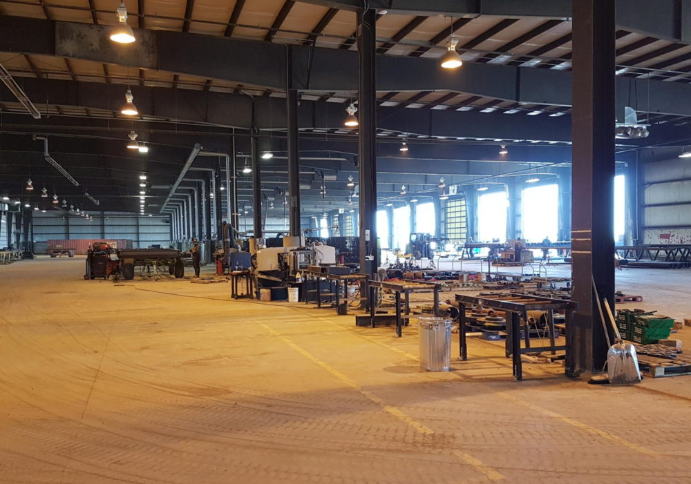 Fabrication & Coating operations at Triple J Pipelines fab shop in Dawson Creek, BC